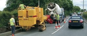 Power Curbers curb machine on road