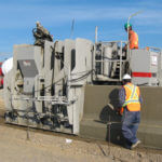 power curber machine creating curb and paving roads