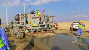 OHL used their Power Paver SF-1700 to pour the concrete base for the railroad.