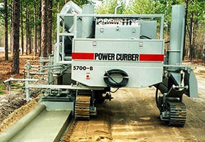 Power Curbers 5700-B curbing machine paving a sidewalk