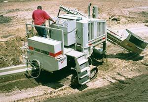 Power Curbers 5700-Super-B curb machine paving a curb