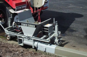 extruded curb with curb machine